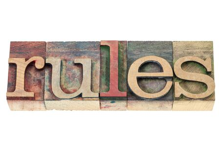 rules word  - isolated text in vintage letterpress wood type blocks stained by color inks Stock Photo - 16849072