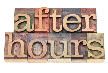 after hours - isolated text in vintage letterpress wood type blocks Stock Photo - 16878507