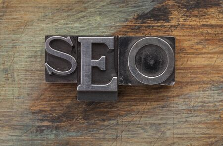 SEO (search engine optimization) acronym - vintage leterpress metal type blocks on a grunge painted wood Stock Photo - 16878510