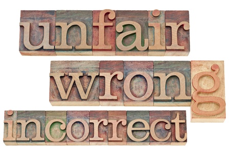 unfair, wrong, incorrect - negative words - isolated text in vintage letterpress wood type blocks Stock Photo - 16878508