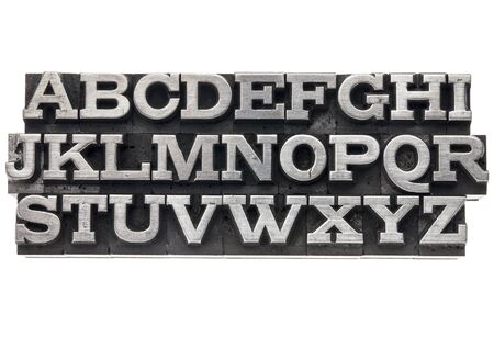 letterpress type: uppercase English alphabet  in vintage metal letterpress type, isolated on white