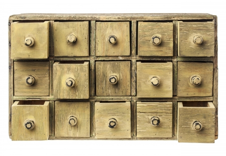 drawers: primitive wooden apothecary or catalog cabinet with partially open drawers - storage or sorting concept