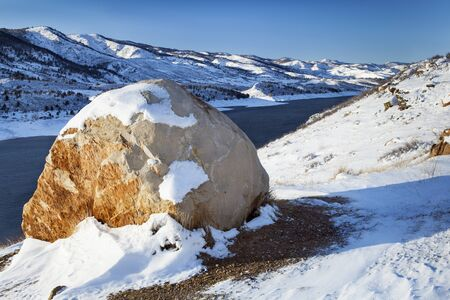horsetooth reservoir: sandstone boulder and Horsetooth Reservoir near Fort Collins, Colorado, winter scenery Stock Photo