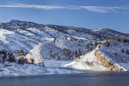 horsetooth rock: Horsetooth Rock and Reservoir near Fort Collins, Colorado, winter scenery with strong wind Stock Photo