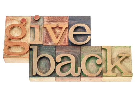 give back - isolated words in vintage letterpress wood type printing blocks Stok Fotoğraf