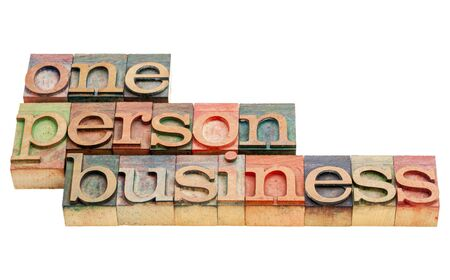 one person business  -isolated words in vintage letterpress wood type printing blocks Stock Photo - 17018068