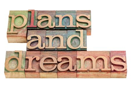plans and dreams -isolated words in vintage letterpress wood type printing blocks Stock Photo - 17018038