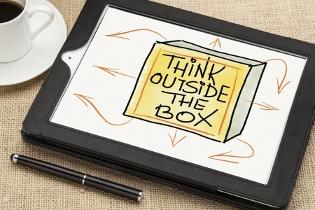 think outside the box - sketch on digital tablet  with a coffee cup and stylus pen photo
