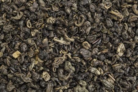 gunpowder: background texture of loose leaf Chinesse gunpowder (pearl) green tea