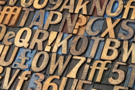 alphabet abstract - vintage letterpress wood type printing blocks stained by black, blue and red ink photo