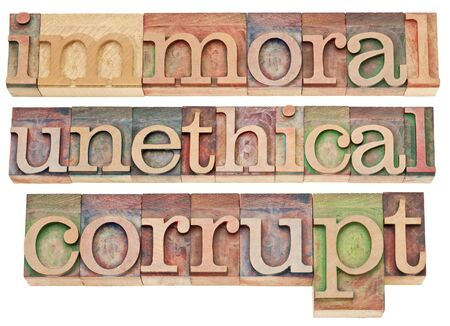 unethical: immoral, unethical, corrupt - ethics concept - a collage of isolated words in vintage letterpress wood type blocks