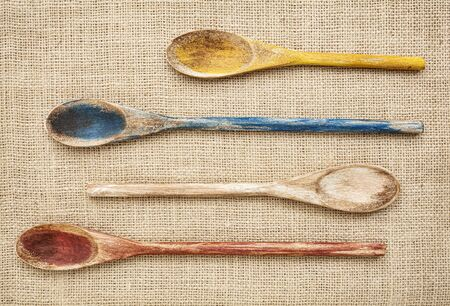 rustic wooden painted spoons on burlap canvas Stock Photo - 17113364