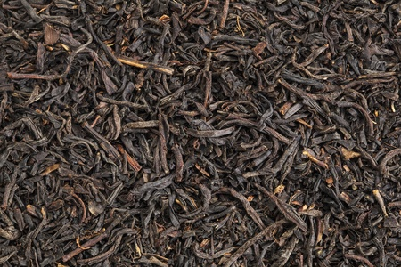 assam: background texture of  loos leaf English breakfast (Assam) black tea from India