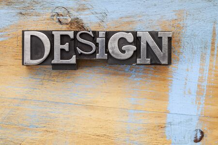 design word in vintage letterpress metal type blocks on wood surface with grunge blue paint Stock Photo - 17113353