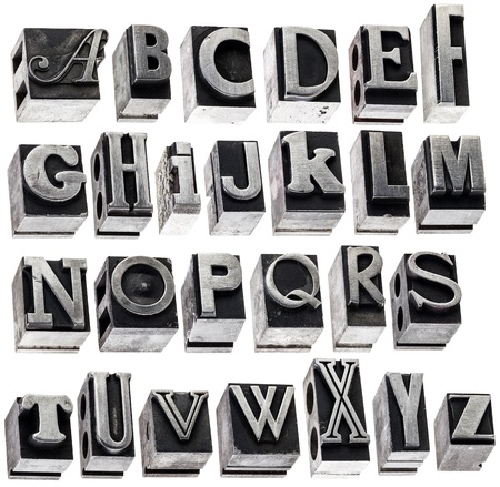 English alphabet - a collage of 26 isolated letters in grunge letterpress metal type block, a variety of fonts photo