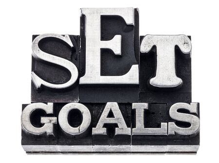 set goal: set goals - isolated text in vintage letterpress metal type blocks, variety of fonts