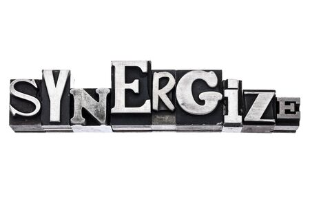 synergize - isolated word in vintage letterpress metal type blocks, variety of fonts Stock Photo - 17155595