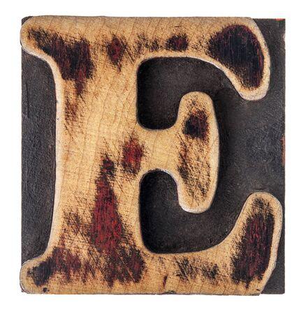 e alphabet: letter E in isolated vintage letterpress wood type printing block