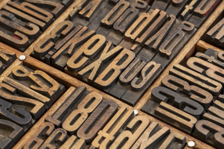 typesetter: vintage letterpress wood type blocks in a typesetter drawer