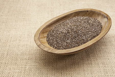 chia seeds in a rustic oval wood bowl against canvas Stock Photo - 17193357