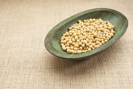 soybeans in a rustic wood bowl against burlap canvas Stock Photo - 17193355