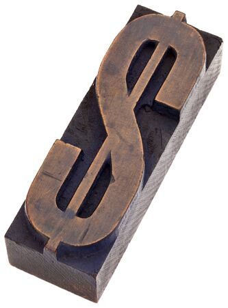 dollar sign in vintage wood letterpress printing blocks, stained by color inks, isolated on white Stock Photo - 17193361