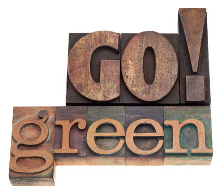 Go green - isolated text in vintage letterpress wood type blocks Stock Photo - 17193362