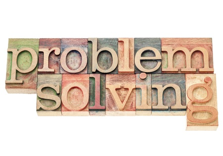 problem solving - isolated words in vintage letterpress wood type printing blocks