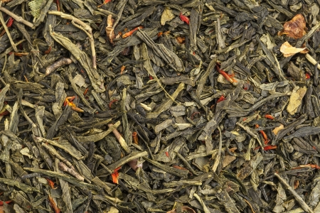background texture of loose leaf green tea with apple fruit and safflower Stock Photo - 17193366