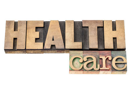 health care  - isolated text in vintage letterpress wood type printing blocks Stock Photo - 17234717