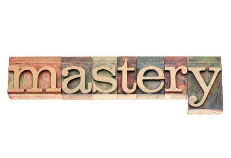 mastery: mastery  - isolated text in vintage letterpress wood type printing blocks Stock Photo