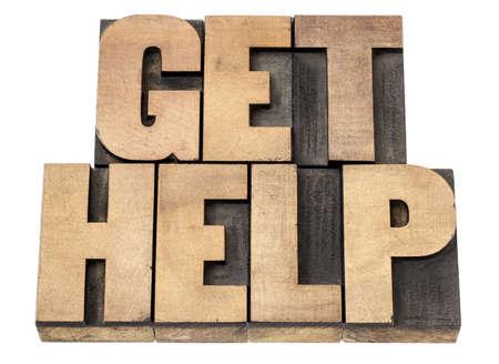 get help - isolated text in vintage letterpress wood type printing blocks