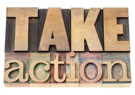 take action - motivation concept - isolated text in vintage letterpress wood type printing blocks Stock Photo - 17305800