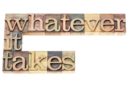 whatever: whatever it takes - determination concept - isolated text in vintage letterpress wood type printing blocks Stock Photo