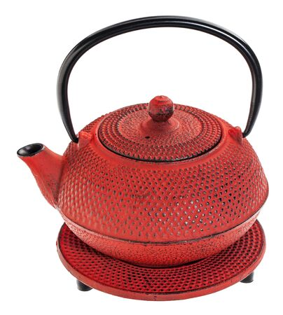 hobnail: red hobnail tetsubin - cast iron traditional Japanese tea pot on a trivet, isolated on white Stock Photo