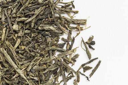 background texture of loose leaf Sencha green tea spilled over white artist canvas Stock Photo - 17305810
