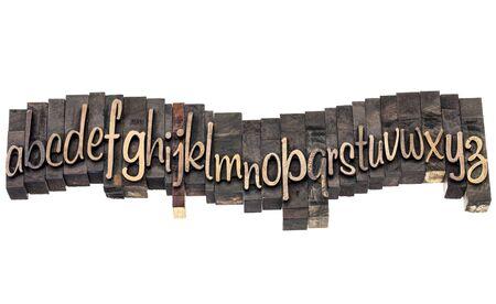 English alphabet in wavy row - letterpress wood type printing blocks, a script font Stock Photo - 17305775