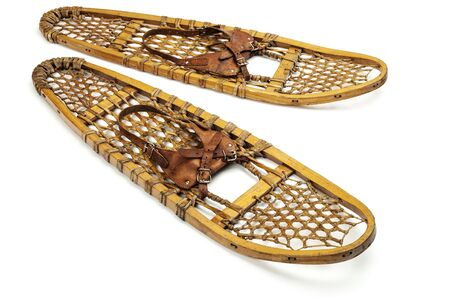 vintage wooden bear paw snowshoes with leather binding on white Stock Photo - 17305835
