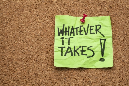 whatever: whatever it takes - motivational slogan - handwriting on a sticky note posted on a cork board Stock Photo