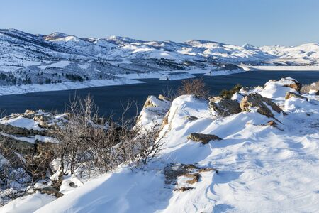 horsetooth reservoir: snow covered trail - Horsetooth Reservoir and dam at Rocky Mountains foothills near Fort Collins, Colorado, winter scenery