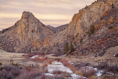 eagle nest rock: winter dusk in mountains - Eagle Nest Rock and North For of Cache la Poudre River in northern Colorado near Fort Collins