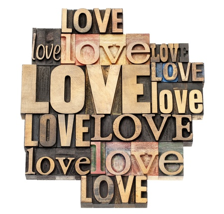 word collage: love word abstract - a collage of isolated text in vintage letterpress wood type printing blocks, a variety of fonts