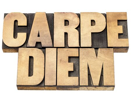 existential: Enjoy life before it is too late, existential cautionary Latin phrase by Horace - Carpe Diem  - isolated text in vintage letterpress wood type printing blocks