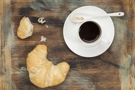 croissants and cup of coffee on grunge painted wood Stock Photo - 17530183