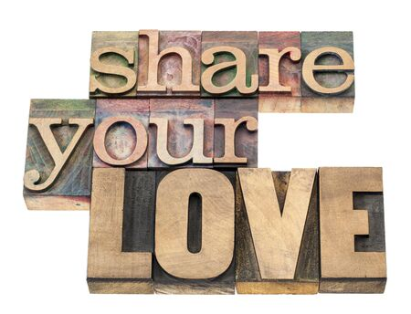 share your love - isolated text in vintage letterpress wood type printing blocks Stock Photo - 17668252