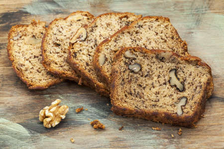 slices of fresh banana bread with walnut on a cutting board Stock Photo - 17668379
