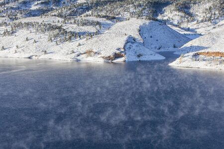 horsetooth reservoir: fog over mountain lake - Horsetooth Reservoir near Fort Collins, Colorado at early winter