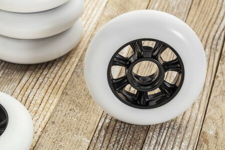 white racing wheels for inline skating on wooden surface Stock Photo - 17668270