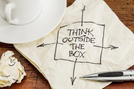 think outside the box - black pen drawing on a cocktail napkin with a coffee cup on a table Stock Photo - 17668269