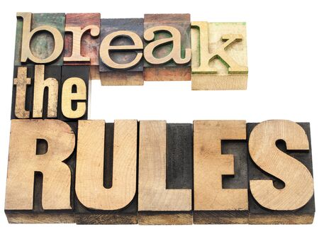 break the rules - refuse to conform - isolated text in vintage letterpress wood type printing blocks Stock Photo - 17806559